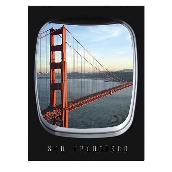 飛行機の窓から眺めるゴールデンゲートブリッジの写真